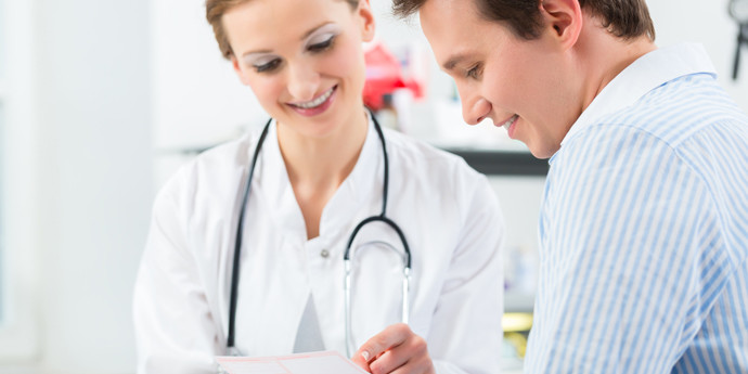 Cancer care specialists reviewing patient care plan document